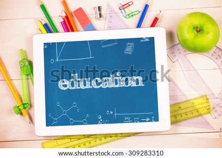 The word education and math and science doodles against students desk with tablet pc - stock photo