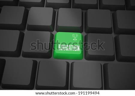 The word education and winners cup on black keyboard with green key