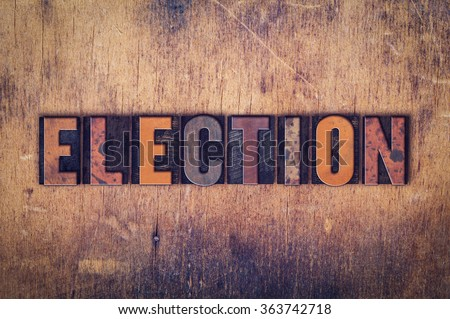 """The word """"Election"""" written in dirty vintage letterpress type on a aged wooden background. - stock photo"""