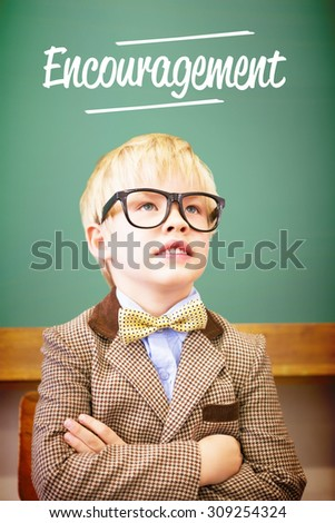 The word encouragement against cute pupil dressed up as teacher in classroom - stock photo