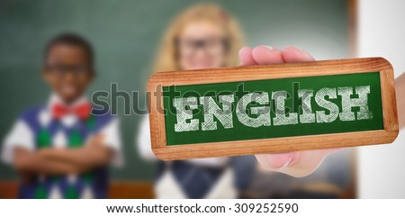 The word english and hand showing chalkboard against pupils smiling at camera with arms crossed - stock photo