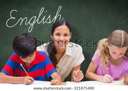 The word english and pretty teacher helping pupils in library against green chalkboard - stock photo