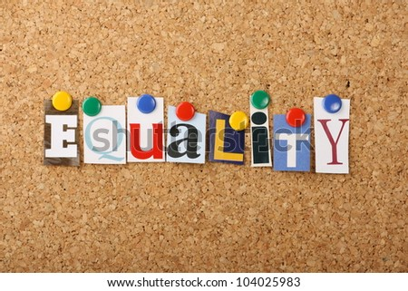 The word Equality in cut out magazine letters pinned to a cork notice board