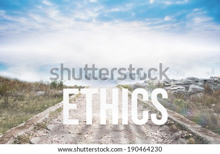 The word ethics against stony path leading to misty cityscape