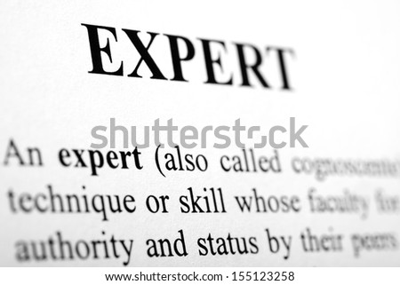 The word Expert shot with artistic selective focus. - stock photo