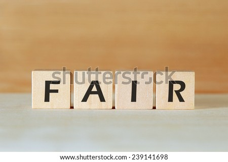 the word FAIR on wood blocks