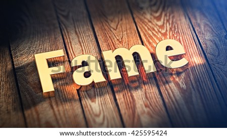 "The word ""Fame"" is lined with gold letters on wooden planks. 3D illustration image - stock photo"