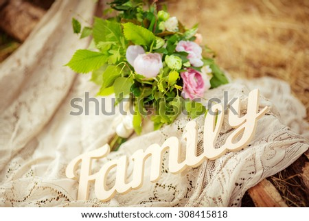 The word FAMILY written in wooden with flowers - stock photo