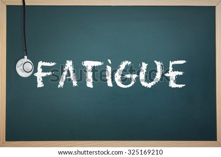 The word fatigue and stethoscope against chalkboard