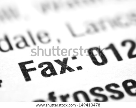 The word FAX closeup on a printed document.