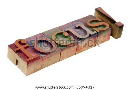 the word focus with exclamation point in vintage wooden letterpress type blocks, stained by color ink, isolated on white - stock photo