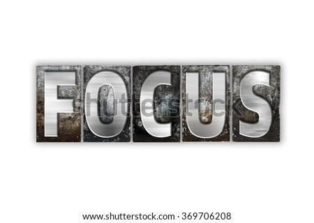 """The word """"Focus"""" written in vintage metal letterpress type isolated on a white background. - stock photo"""