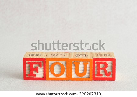 The word four (4) spelled with colorful alphabet blocks isolated against a white background - stock photo