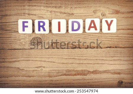 The word FRIDAY written in wooden letterpress type. - stock photo