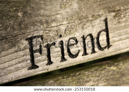 """The word """"Friend"""" engraved on wood.  - stock photo"""