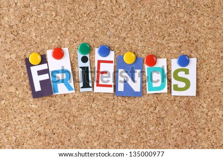 The word Friends in cut out magazine letters pinned to a cork notice board with multicolored drawing pins as a concept for social media and networking
