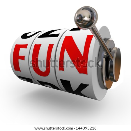 The word Fun on slot machine wheels or dials to illustrate entertainment and enjoyment of having a good time gambling on slots and other games of chance at a casino - stock photo