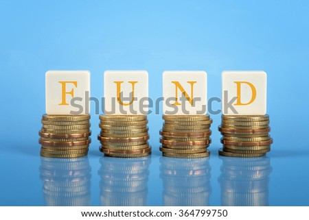 The word Fund on stacked coins, finance conceptual