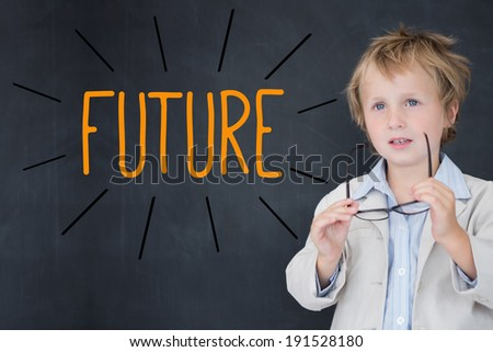 The word future against schoolboy and blackboard - stock photo