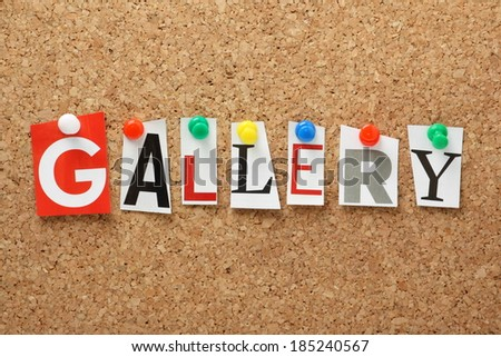 The word Gallery in cut out magazine letters pinned to a cork notice board