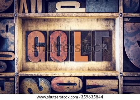 "The word ""Golf"" written in vintage wooden letterpress type. - stock photo"