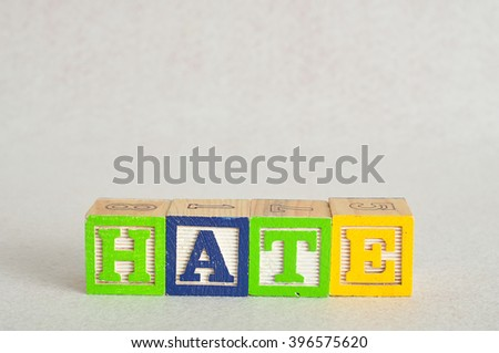 The word hate spelled with colorful alphabet blocks isolated on white background
