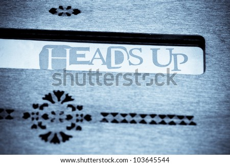 The Word headsup isis highlighted with a wooden decoration board in black and white - stock photo