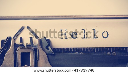 The word hello against close-up of typewriter - stock photo