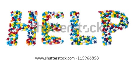 The word help made out of colorful pills isolated on white.
