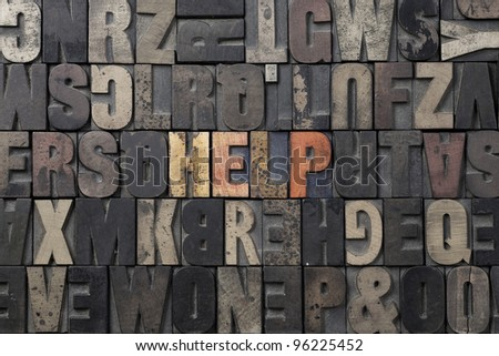 The word Help written in antique letterpress printing blocks. - stock photo
