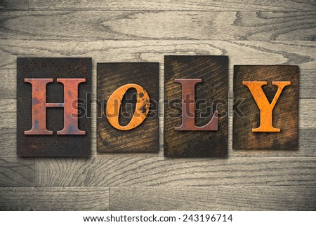 """The word """"HOLY"""" written in wooden letterpress type. - stock photo"""