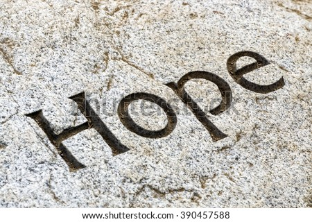 """The word """"Hope"""" etched in white rock. - stock photo"""