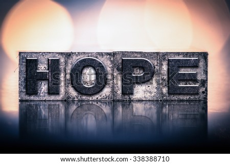 """The word """"HOPE"""" written in vintage ink stained letterpress type. - stock photo"""