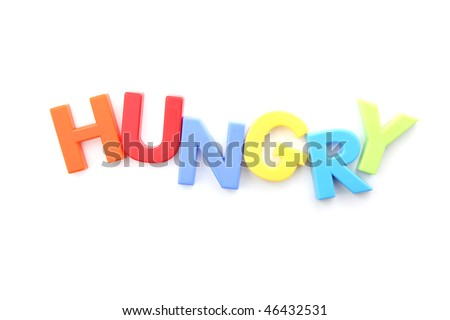 The word 'hungry' spelled out using colored fridge magnets, isolated on white