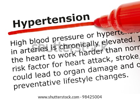 The word Hypertension underlined with red marker on white paper. - stock photo