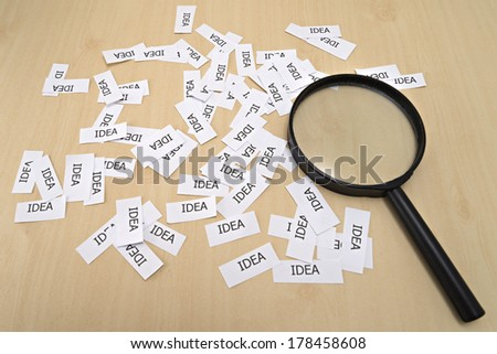 The word, IDEA and magnify glass - stock photo