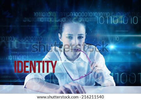 The word identity and businesswoman typing on a keyboard against blue technology design with binary code