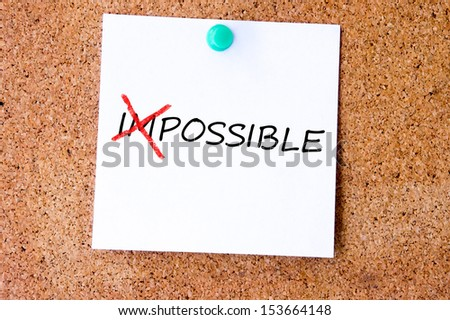 The word Impossible turning into Possible on white sticky note. - stock photo