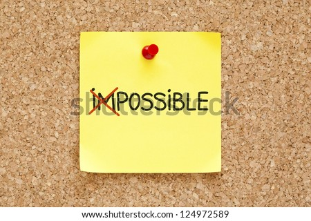 The word Impossible turning into Possible on yellow sticky note.