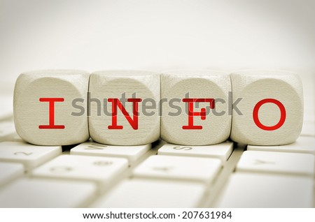 the word info on cubes on a keyboard - stock photo