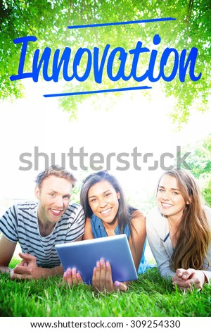 The word innovation against happy students using tablet pc outside - stock photo