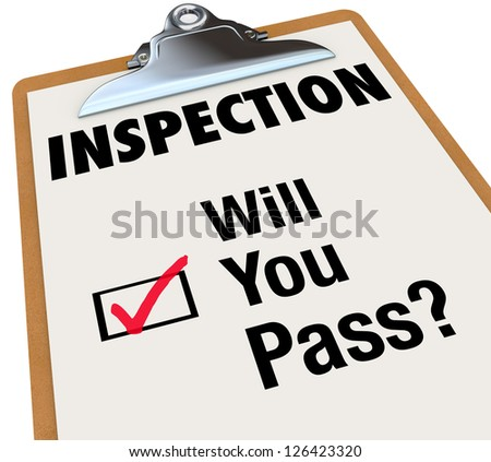 The word Inspection on a checklist attached to a clipboard, and words for the question Will You Pass? and a checkbox with red check mark indicating you have been approved or accepted or passed a test - stock photo