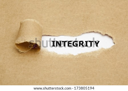The word Integrity appearing behind torn brown paper. - stock photo