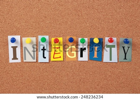 The word Integrity in cut out magazine letters pinned to a cork board. - stock photo