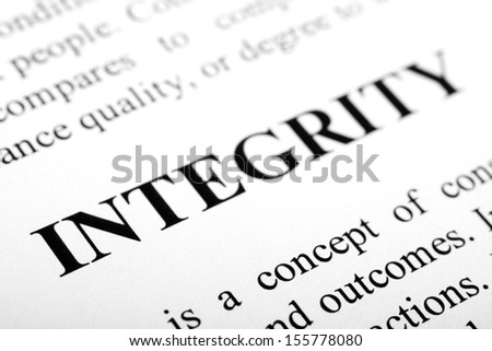 The word Integrity shot with artistic selective focus. - stock photo
