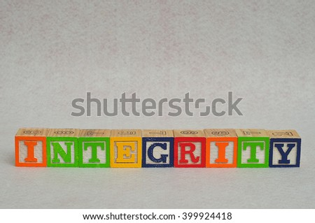 The word integrity spelled with colorful alphabet blocks isolated on white background