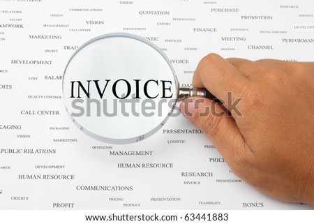 The word INVOICE is magnified.