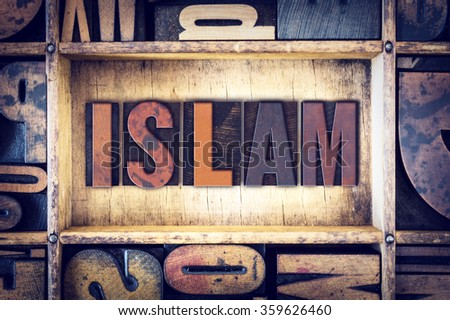 "The word ""Islam"" written in vintage wooden letterpress type."