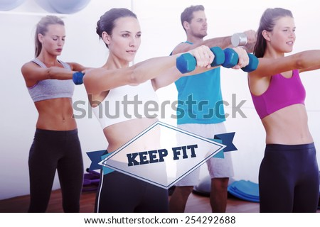 The word keep fit and class exercising with dumbbells in gym against badge - stock photo