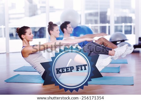 The word keep fit and class stretching on mats at yoga class against badge - stock photo